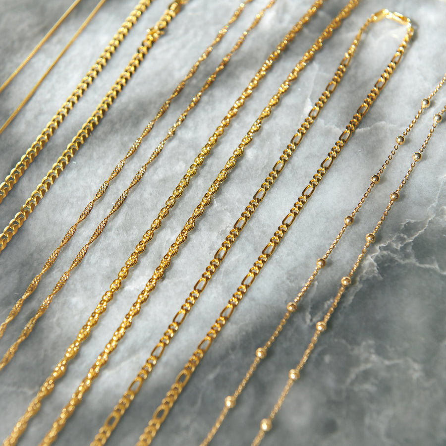 18 karat gold vermeil chains marble flay lay