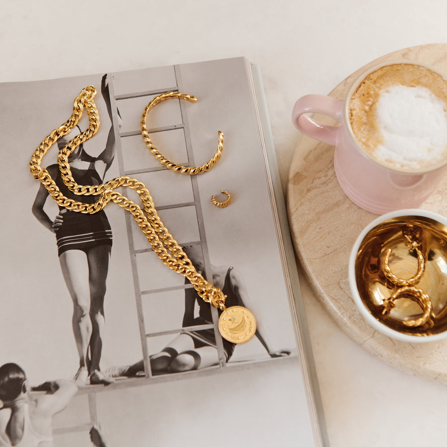 gold jewelry flat lay coffee