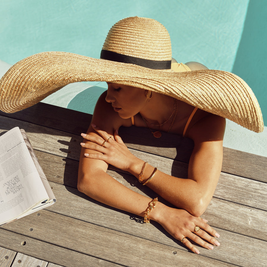 pool straw hat gold jewellery