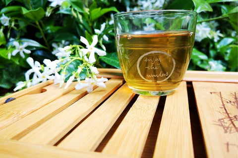 Glass Cup of Green Tea On wooden table