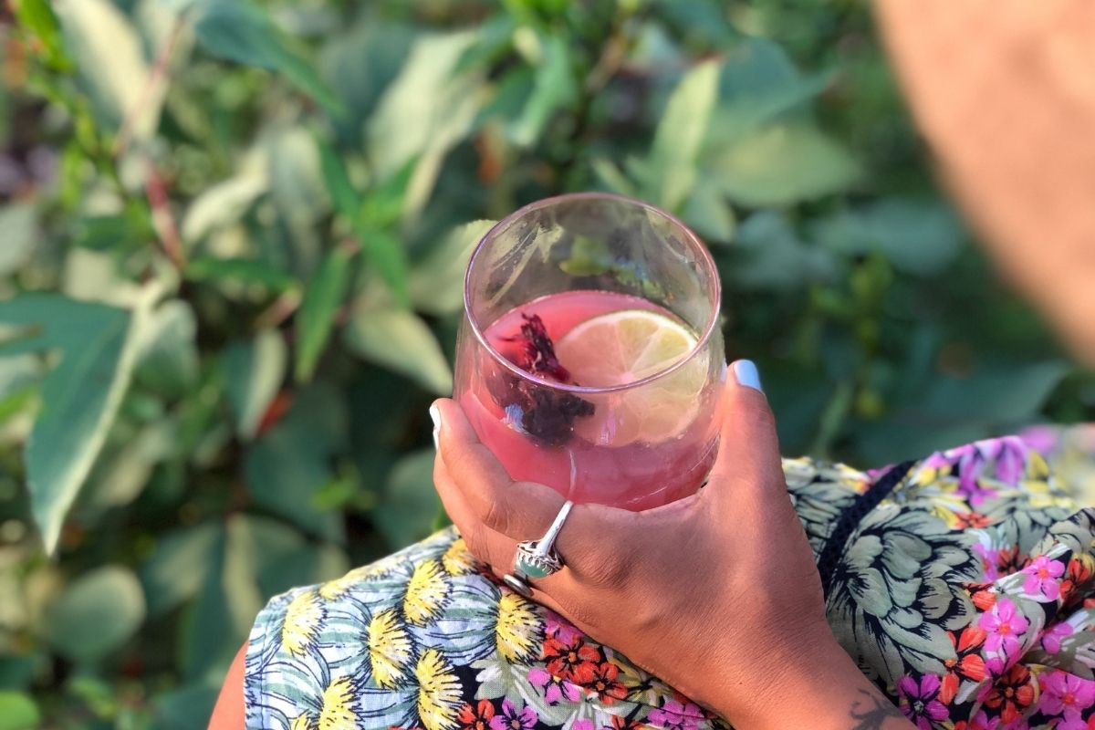 woman drinking iced hibiscus tea