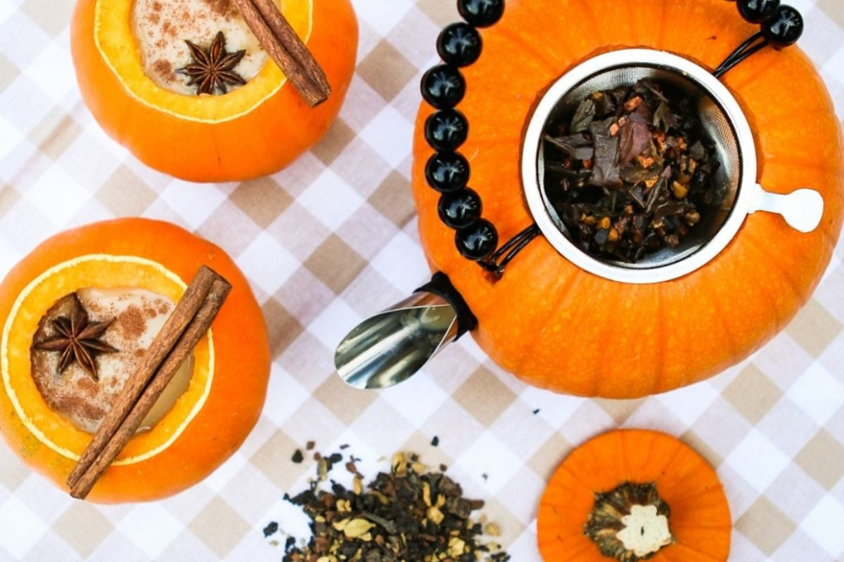 hollowed out pumpkins turned into teapot and cups