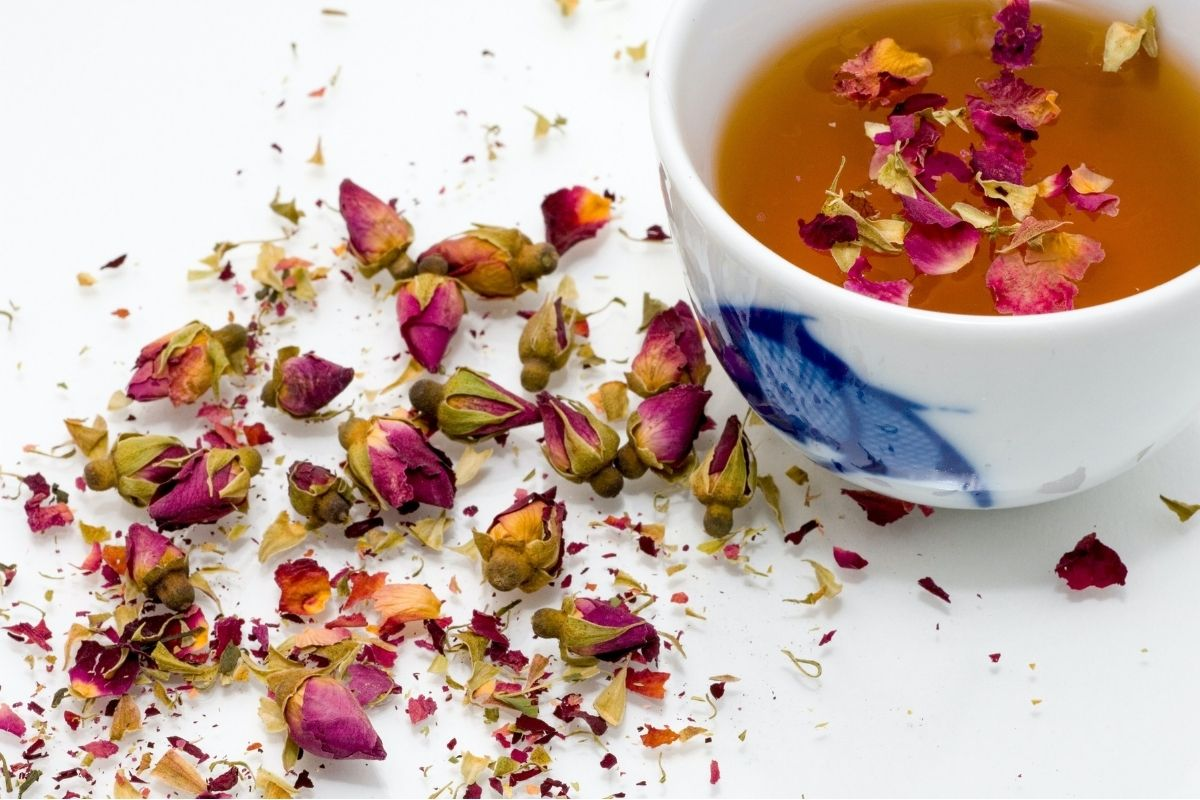 flower petals and cup of tea