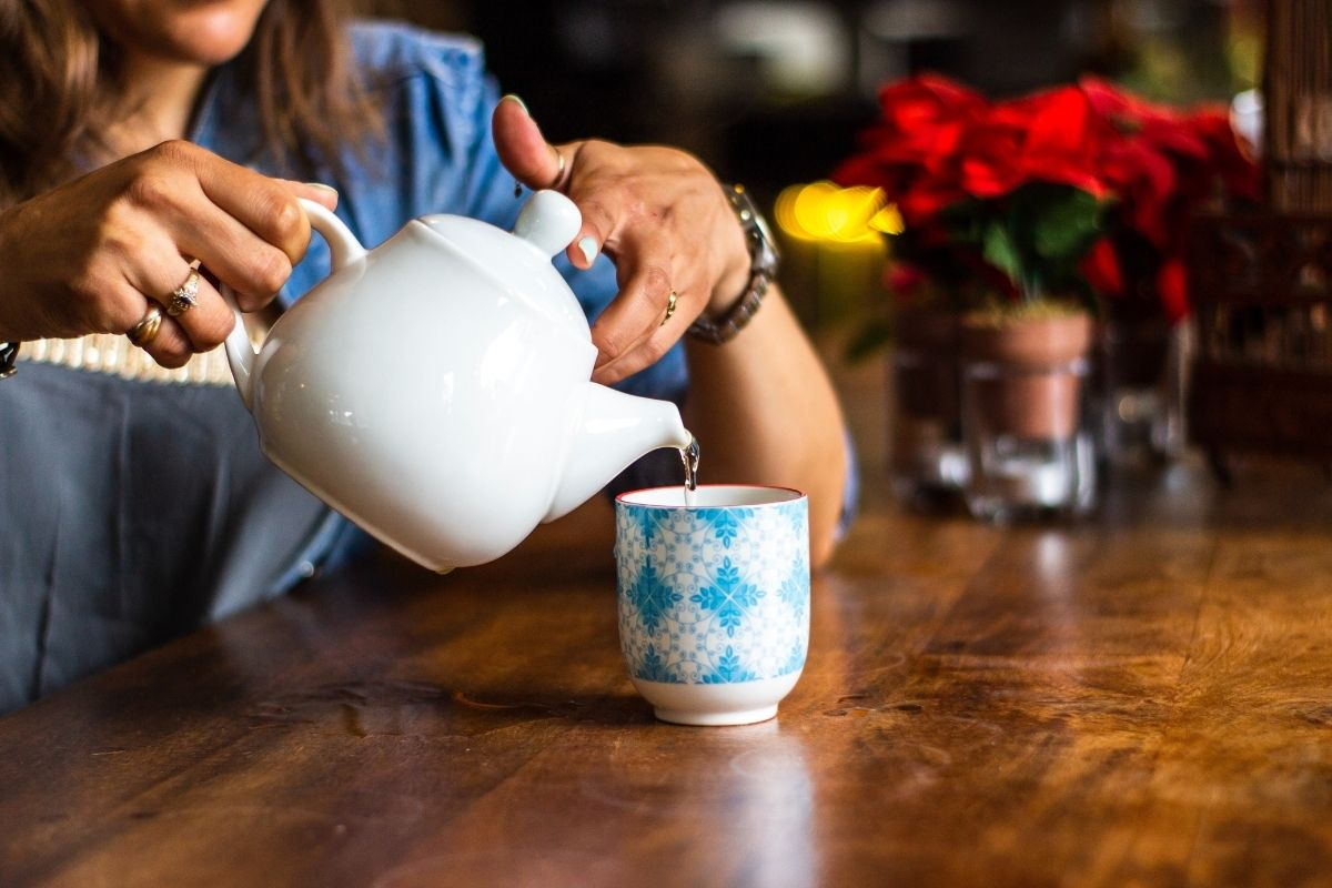 woman pouring cup of tea