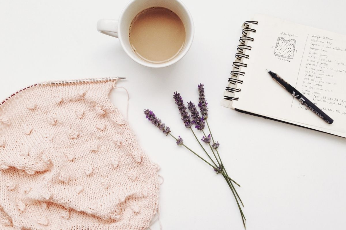lavender flowers, blanket, notebook and cup of tea
