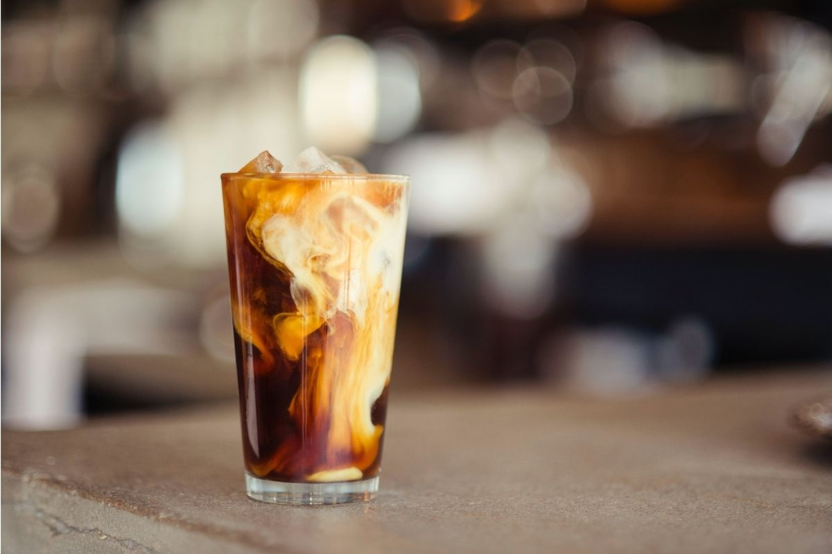 cup of iced tea on wooden counter