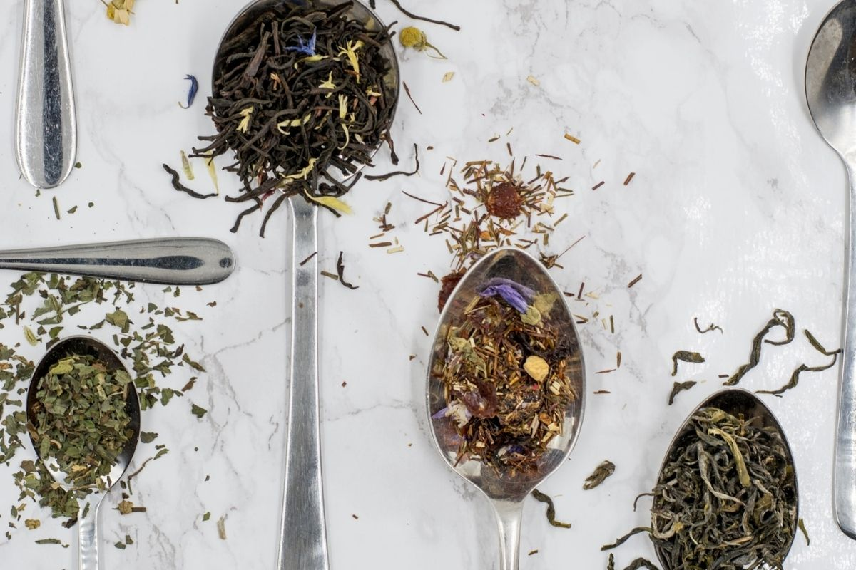 teaspoons with different dried teas