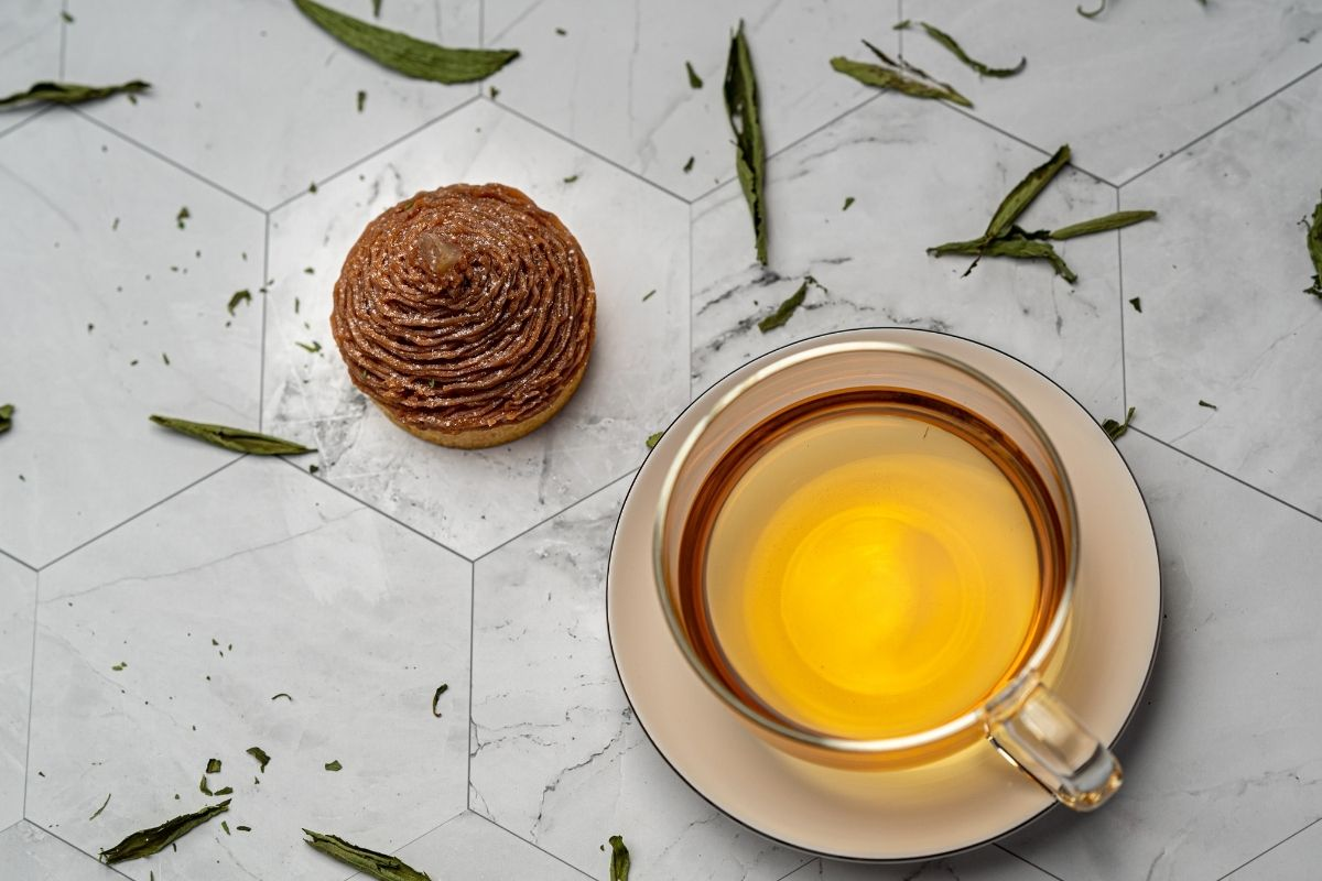 tea next to cake and leaves