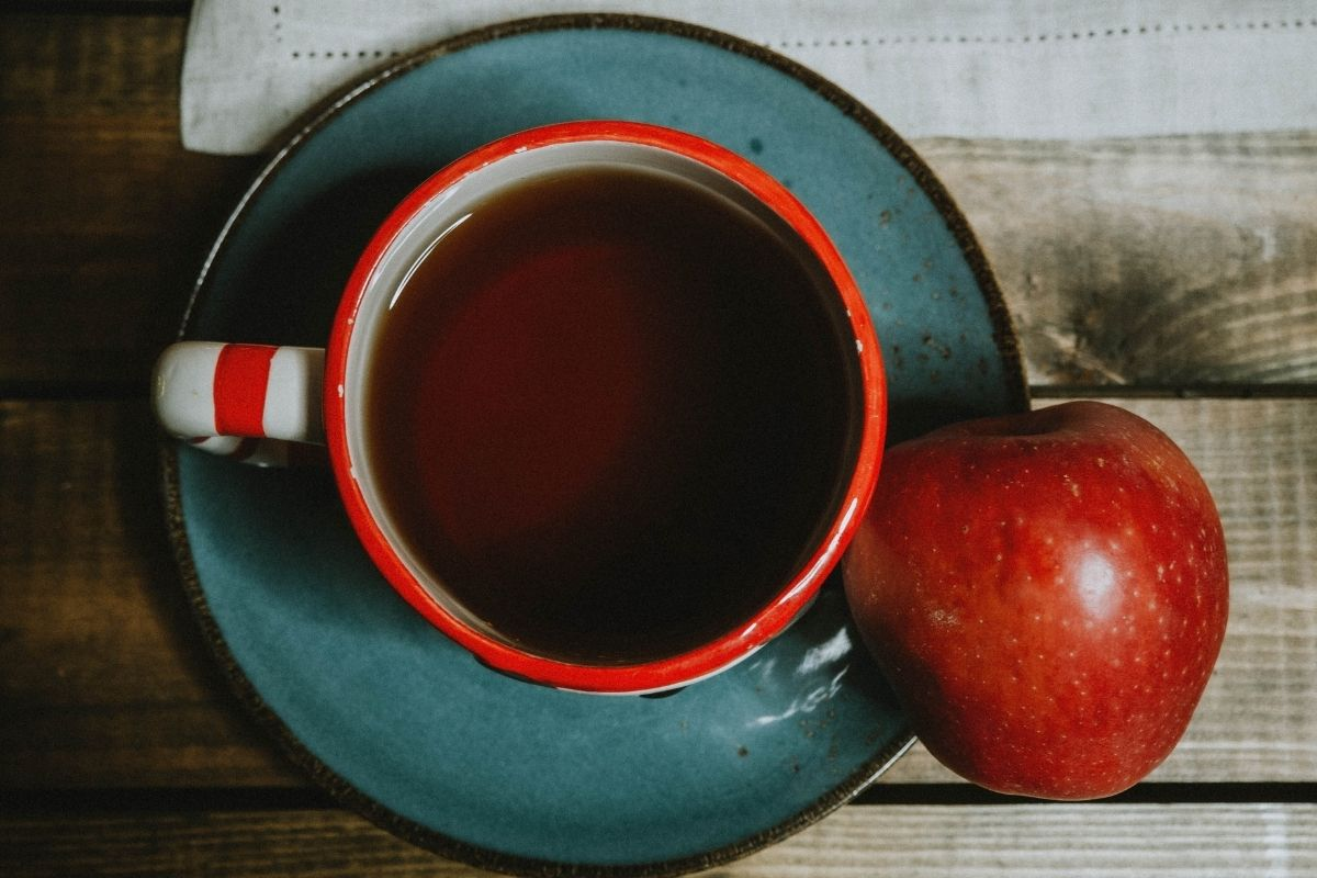 apple next to cup of tea