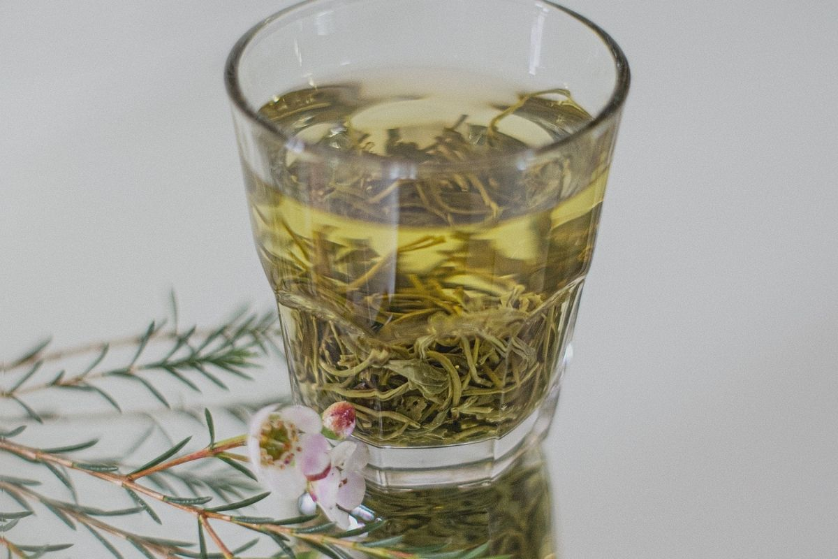 glass of rosemary tea with flowers