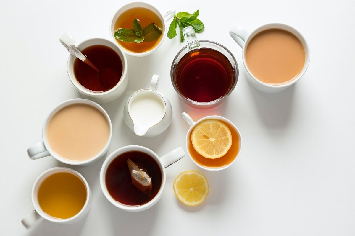 different cups of tea against a white backdrop