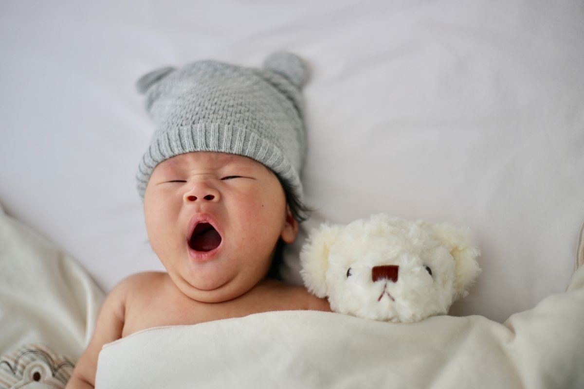 baby yawning in bed
