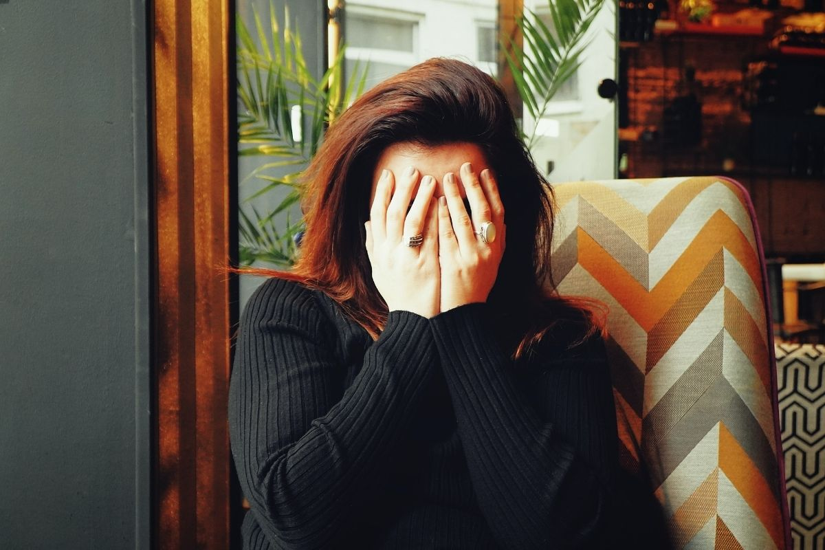 woman with hands over face waiting for tea for headaches
