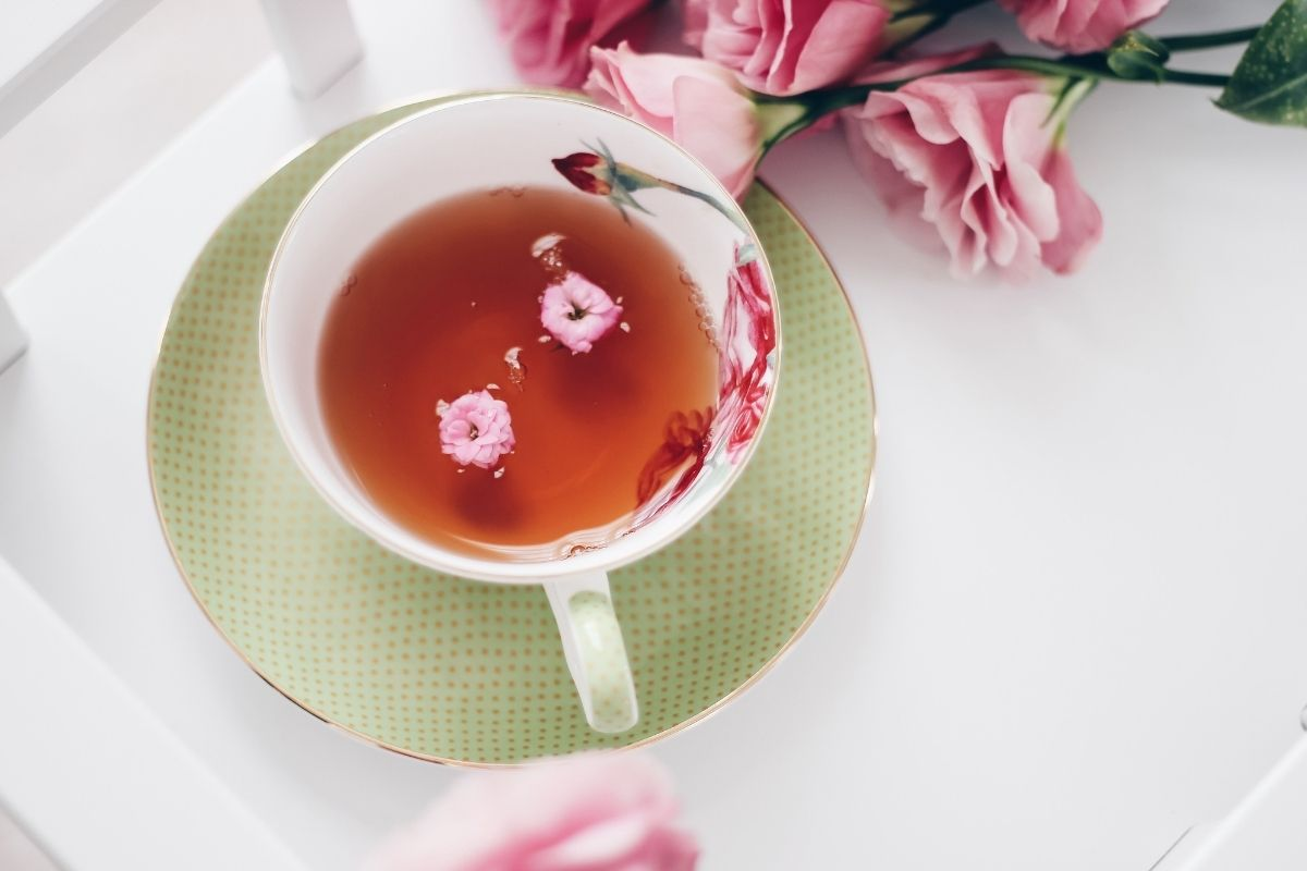cup of tea with pink flowers
