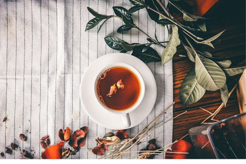Black tea with leaves and petals