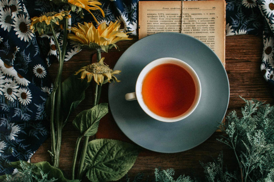 oolong tea on wooden table with flowers