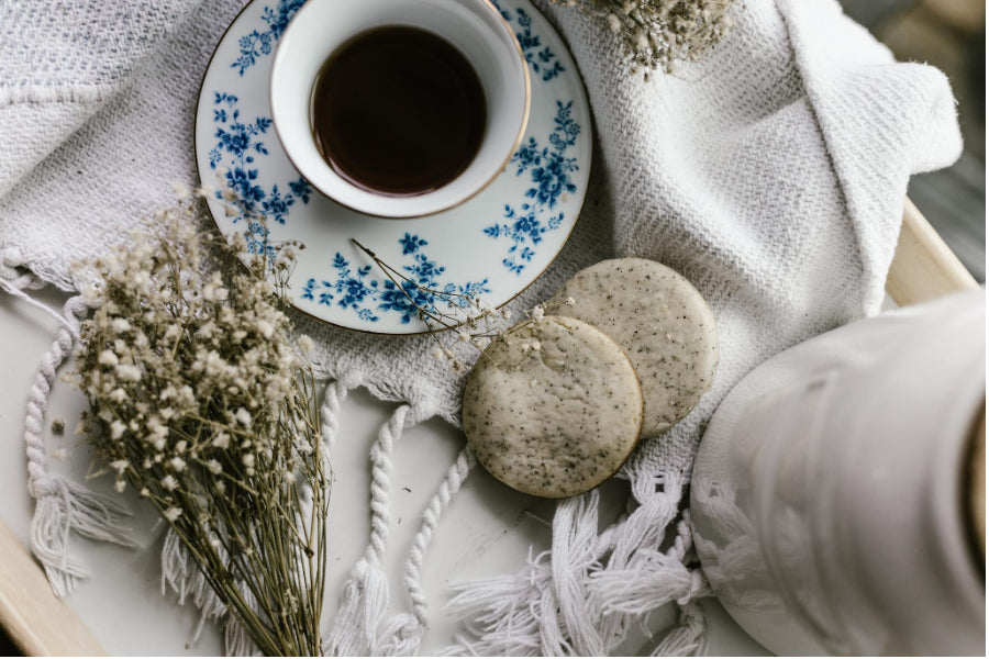 earl grey tea with cookies on cloth table
