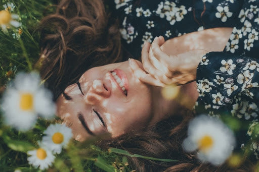 woman lying in field with flowers