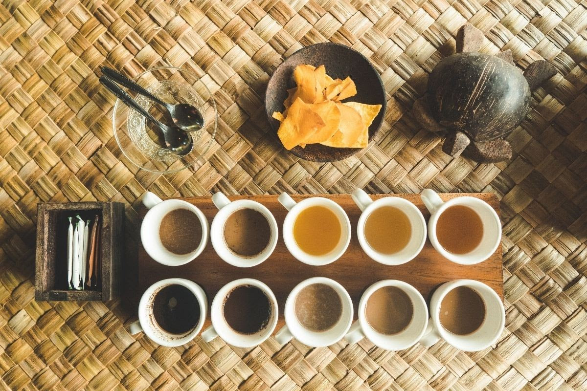 selection of cups of tea in a row