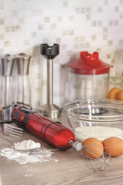 Red Hand Blender on the cooking pass with eggs