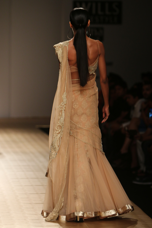 Sun Kissed Peach Net Frill Lehenga Sari with Paisley Border Drape with Booti Petticoat And Paisiley Bustier Blouse