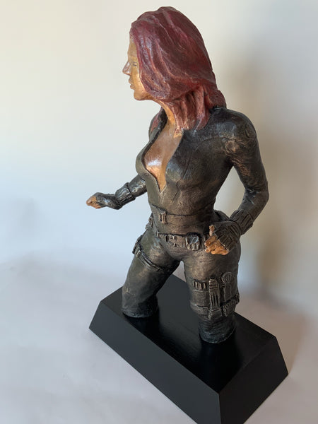 Stoneware Sculpture  Superhero Black Widow in skintight leather jumpsuit stands in readiness to kick ass