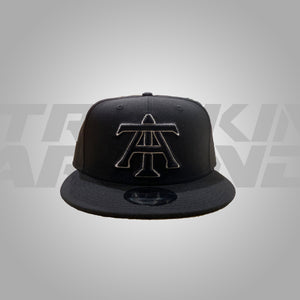 BLACK AND WHITE NEW ERA SNAPBACK