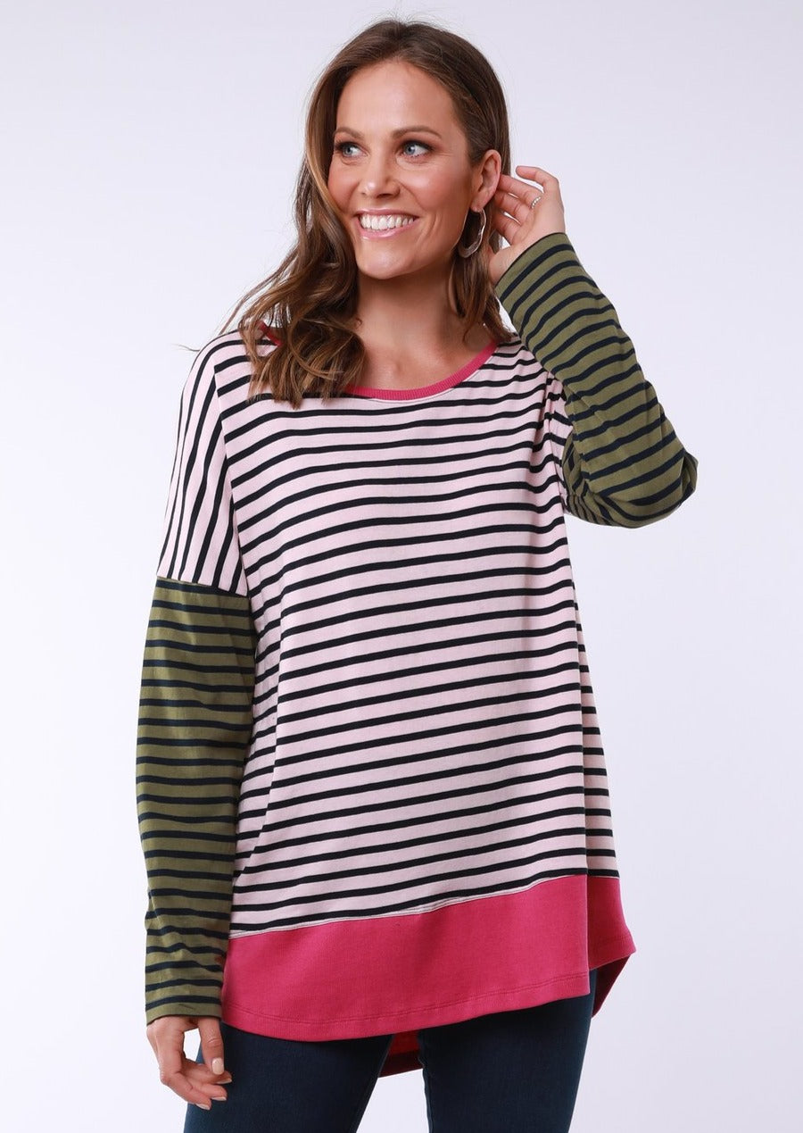 Long sleeved striped tee. Sleeves are khaki with navy stripe, body of tee is pale pink with a navy stripe. The bottom of the tee and collar are hot pink.