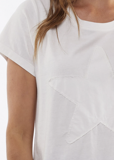 A zoomed in image that focus' on the star detail on the front of the white t-shirt. The edges of the white star are frayed.