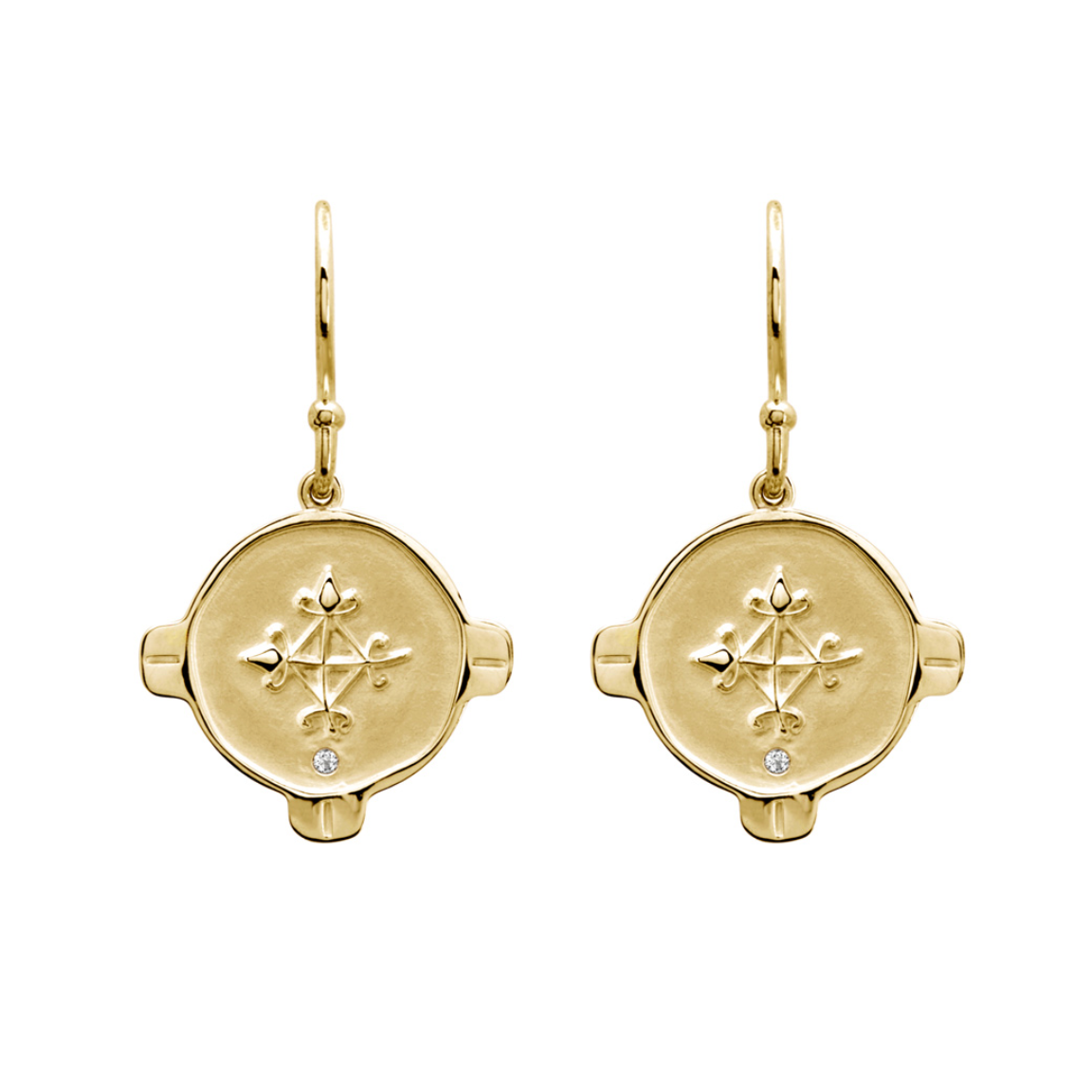Gold earrings, circle shape with a cross type design in the middle with a small white topaz at the bottom of the circle.