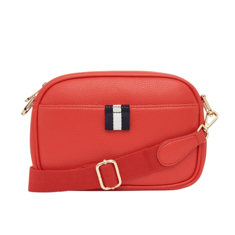 Red round rectangular bag with gold details and small navy and white tab.