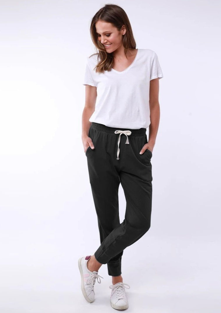 Female wearing  white t-shirt and black lounge pants