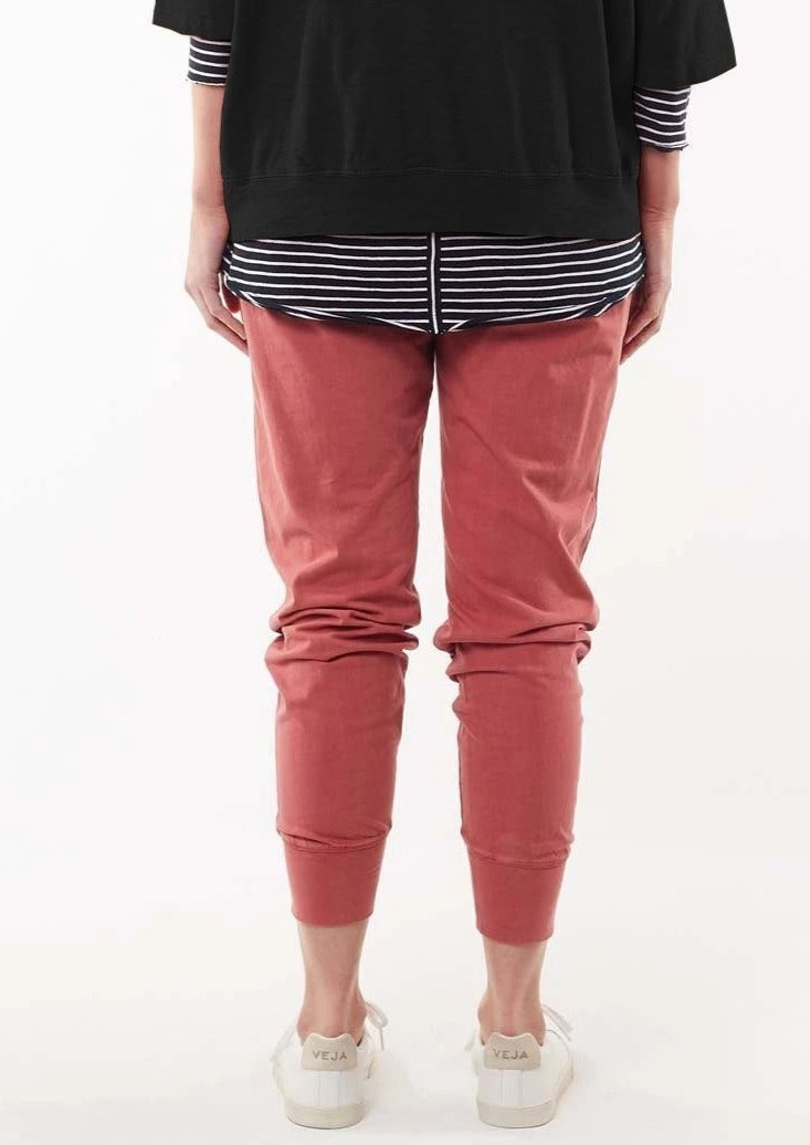 Female in deep rose lounge pant.