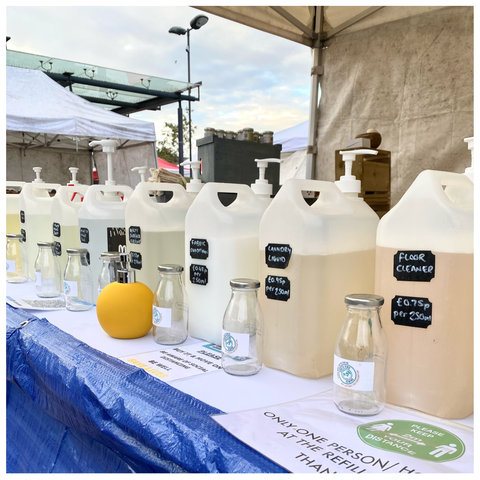 Neston Market refilling station with a range of ethical and sustainable cleaning liquids. The range includes liquid hand soap, bath and body wash, laundry liquid, fabric conditioner, washing up liquid, toilet cleaner, floor cleaner, disinfectant hand rub and multi-surface spray cleaner.