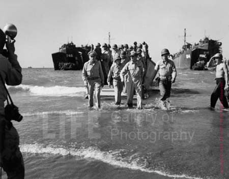 General Macathur and General Richard Sutherland Wading Ashore by Carl Mydans