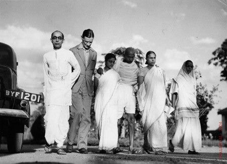Mohandas Gandhi walking with Horace Alexander by Margaret Bourke-White