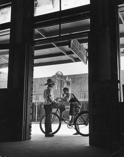 Post Office with two boys and bicycle by Andreas Feininger