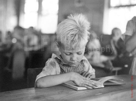 Boy Reading in School by Carl Mydans