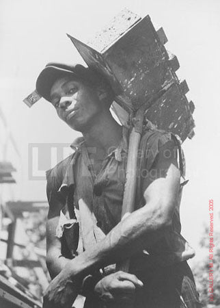 Brick Carrier at Model Community by Carl Mydans