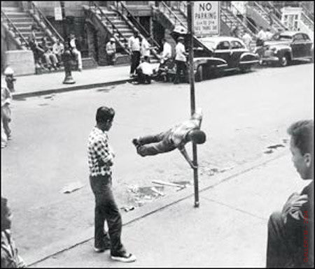 Boy Chinning on Pole by Walter Rosenblum