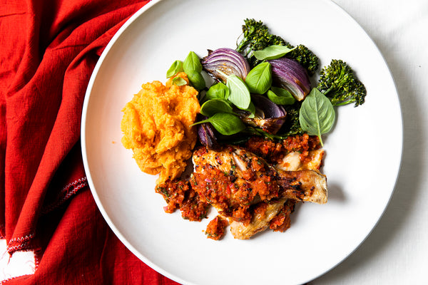 Peri peri chicken with sweet potato mash & roasted red onion