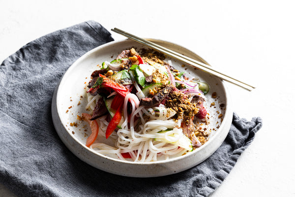 Thai beef salad, vegetables, rice noodles