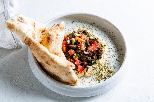 Hummus, lamb, vegetables, flatbread