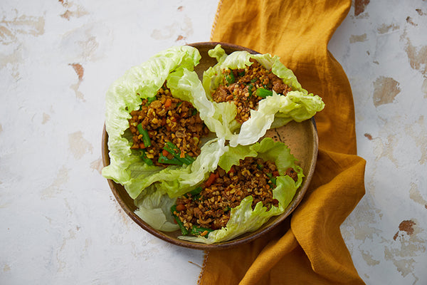 Pork lettuce cups with mixed vegetables, peanuts & fried shallots