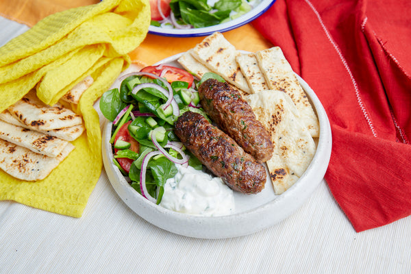 Lamb 'seekh' kebabs with warm naan bread & coriander yogurt