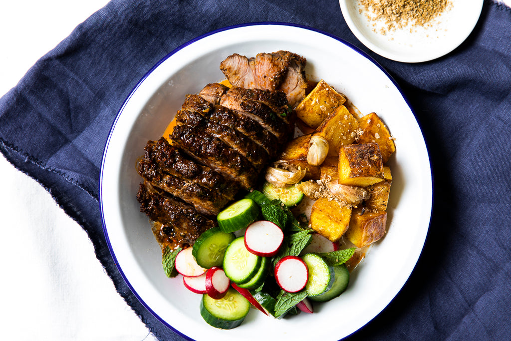 Spiced lamb leg with cumin potatoes & cucumber & mint salad