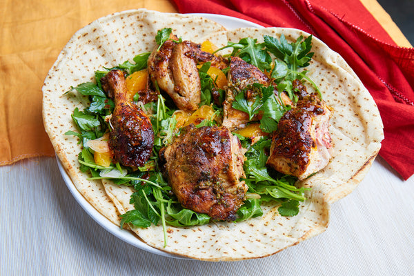 Spiced honey chicken with an orange & herb salad