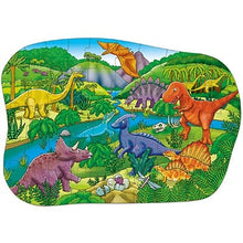 Load image into Gallery viewer, This beautifully illustrated jigsaw depicts a wide array of dinosaurs, from a triceratops to a t-rex, in a lush, prehistoric setting.