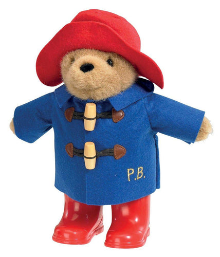 Classic Paddington Bear in Boots - Dressed in his finest trademark duffel coat, (which comes with real wooden toggles) it even has his initials P.B stitched in with beautiful golden thread. His classic red hat and red wellington boots complete his look, alongside a tag which reads