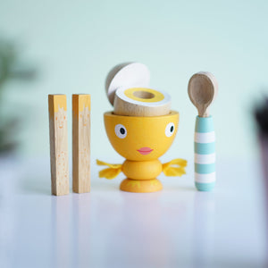 Made of solid rubberwood and finished in water-based colours, the egg cup has hand stitched felt wings, wooden egg with magnetic top, two hand painted solid rubberwood 'soldiers' and a painted wooden spoon. A great gift for age 2 and over.